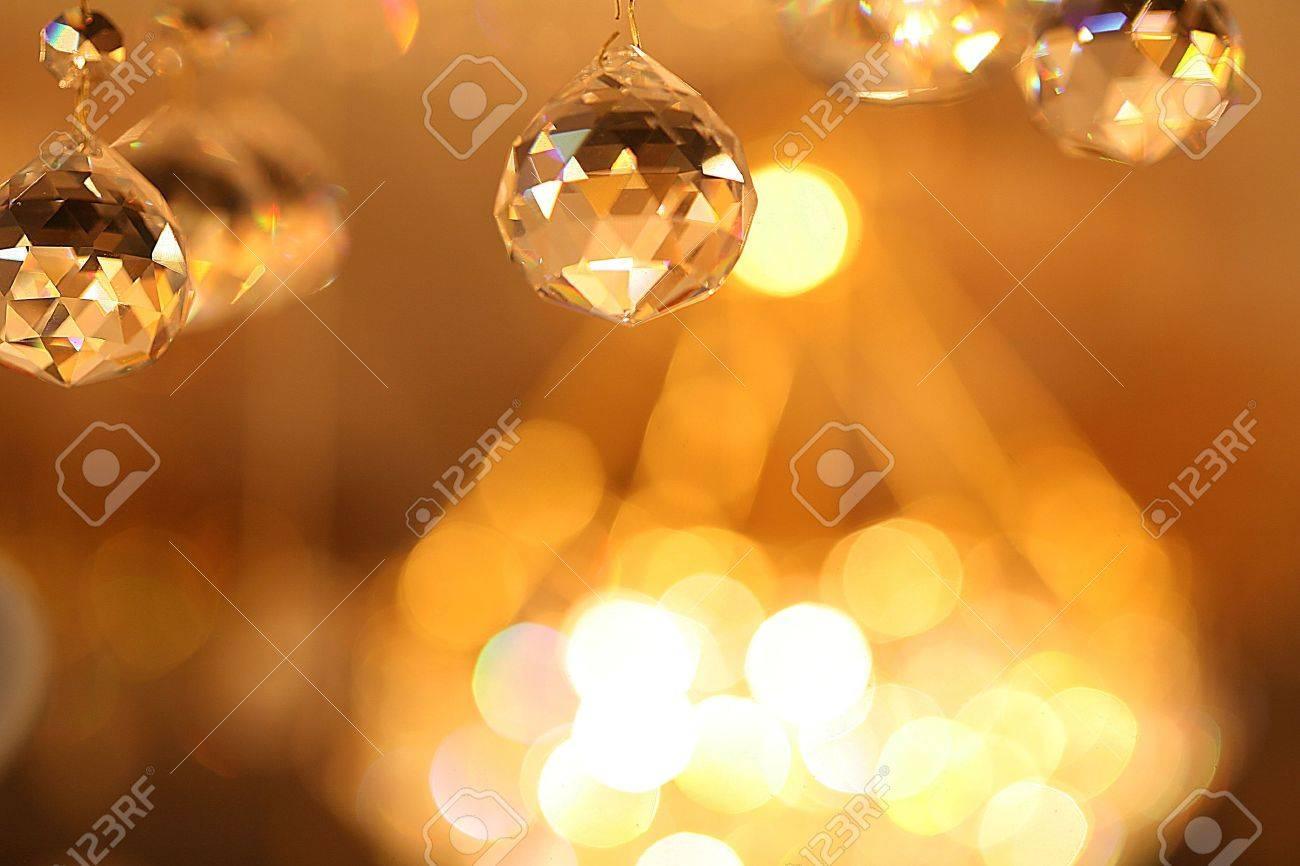 Chandelier beautiful reflections of light inside the room Stock Photo - 9502799