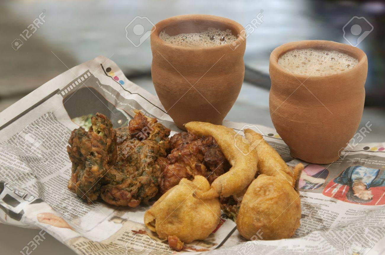 Indian pakoras,bhajiyas and fried potato balls with chai in traditional