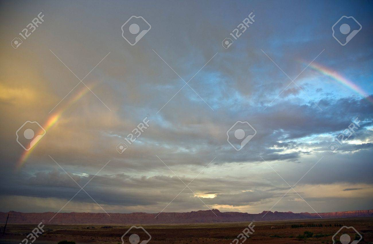 Echo Cliffs with dramatic sky at sunset near Great Canyon with rainbow Stock Photo - 9163493