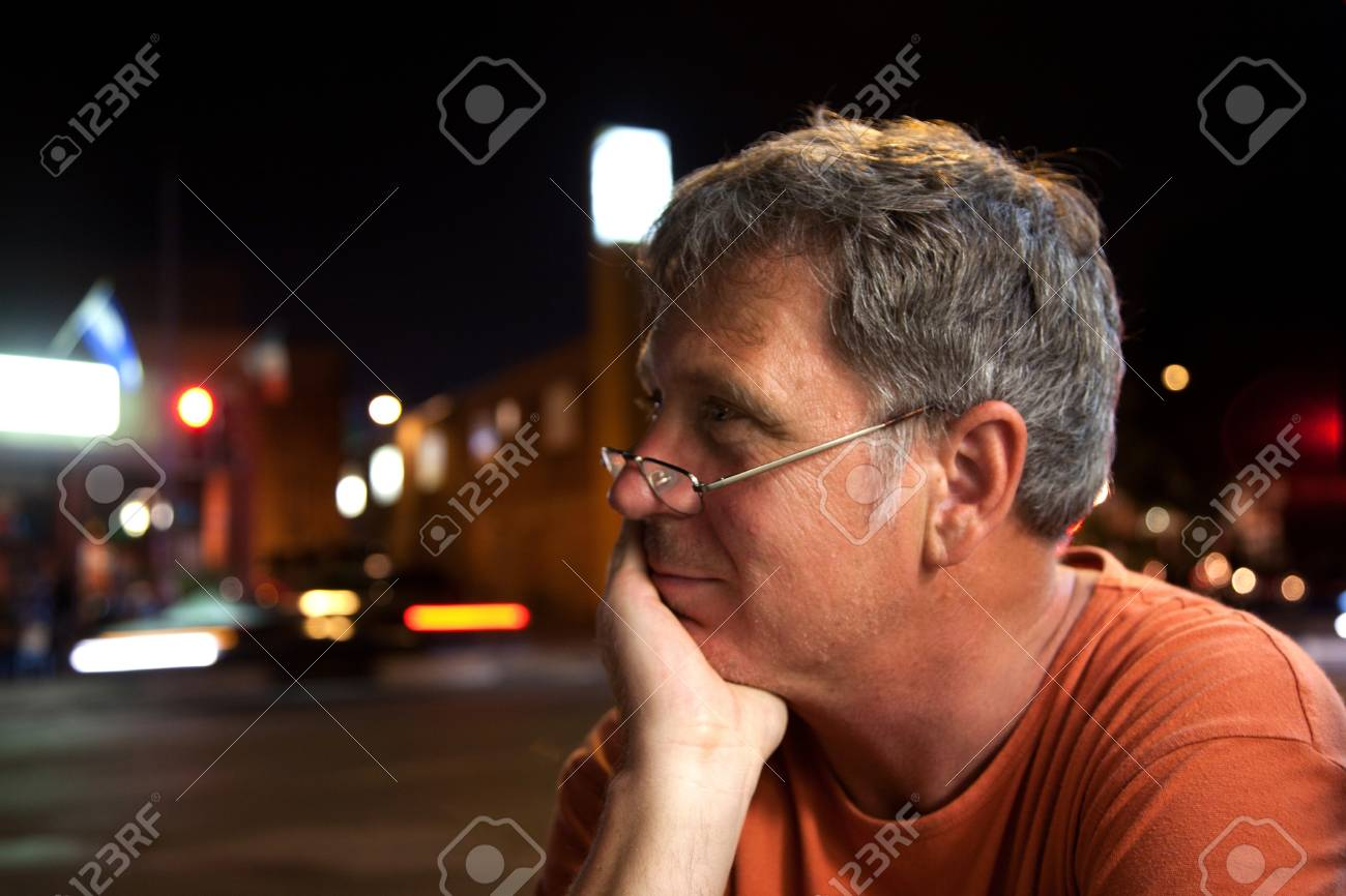 man sitting outdoors by night Stock Photo - 9219056