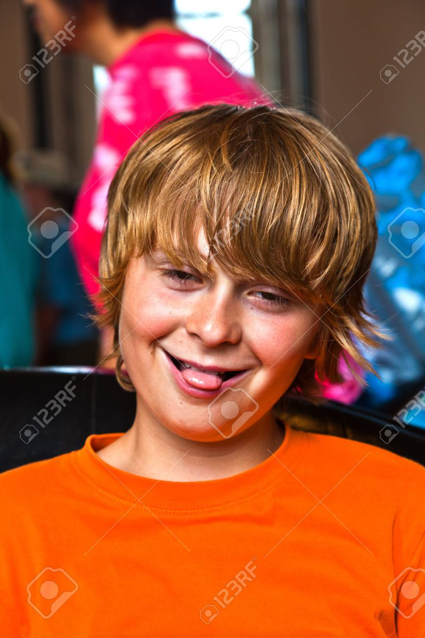 boy takes a rest at a sofa in the Entrance of the Smithonean Museum in Washington Stock Photo - 9223474