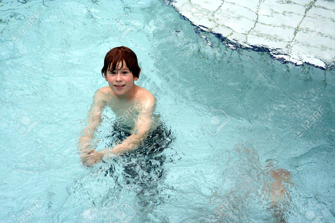 young boy with red hair has fun in the public  indoor pool Stock Photo - 9219933