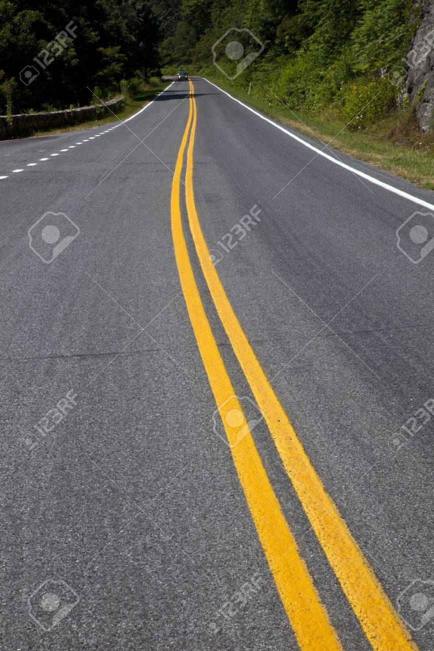Beautiful scenic country road curves through Shenandoah  National Park. Stock Photo - 9367519