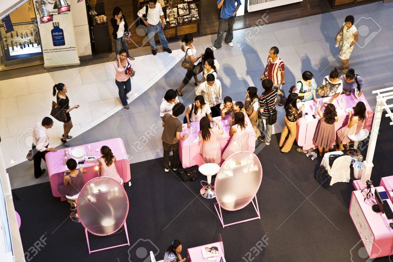 BANGKOK, THAILAND - May 8:  Shopping Mall Central World, Hostesses from AMWAY are advising customers how to use their products and offering Skin Analysis with Photo and Laptop,  May 8, 2009 in Bangkok, Thailand Stock Photo - 9500921