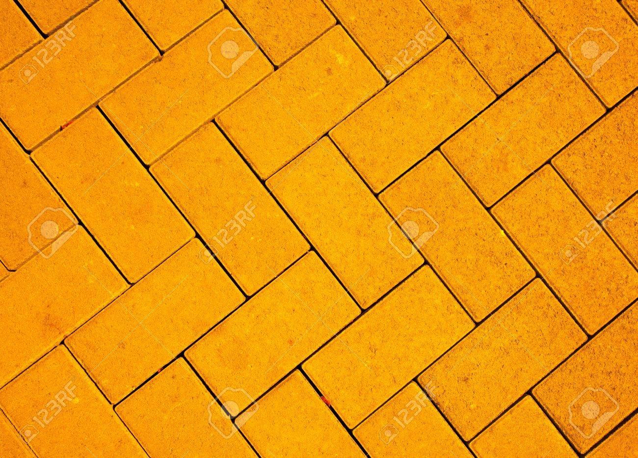 foto de archivo patrn de pavimento hecho con bloques de hormign de reparto en color amarillo