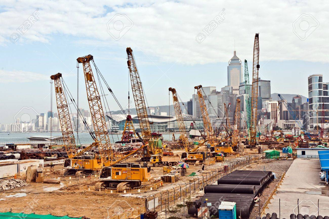 VICTORIA, HONGKONG - JANUARY 09: view to the construction sites near  the harbor of Victoria on January 09,2010, Victoria, Hongkong. They build new skyscrapers and rents are on the top in Hong Kong. Stock Photo - 10249650