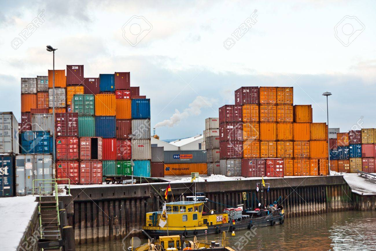 MAINZ, GERMANY - JANUARY 1: ships in container harbor in Winter on January, 1, 2010 in Mainz, Germany. He was constructed by Eduard Kreyssig between 1880 and 1887 on base of a roman war harbor. Stock Photo - 10274024