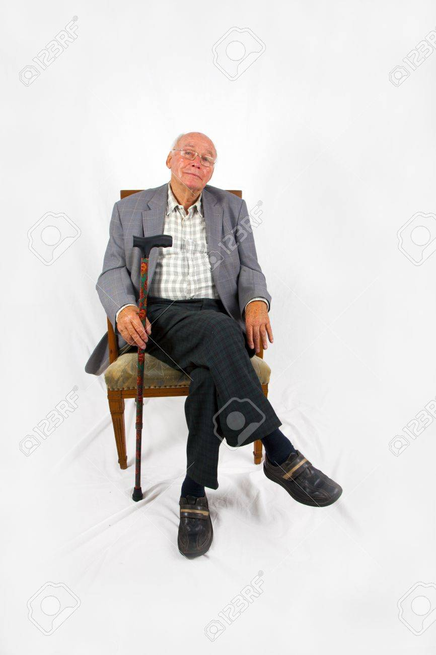 Old Man Sitting In The Armchair With His Walking Stick Stock Photo ...