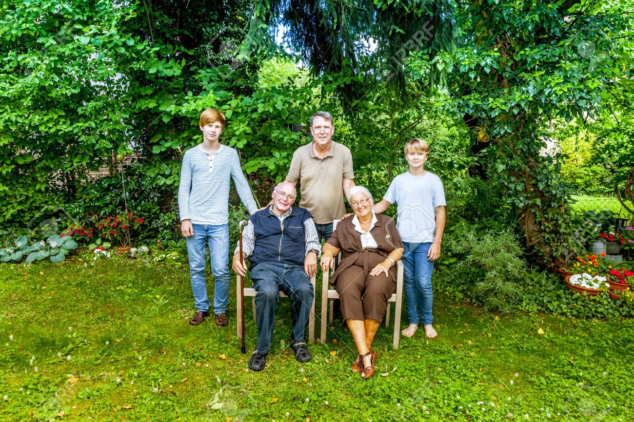 extended family group posing in the garden with grandparents Stock Photo - 12860321