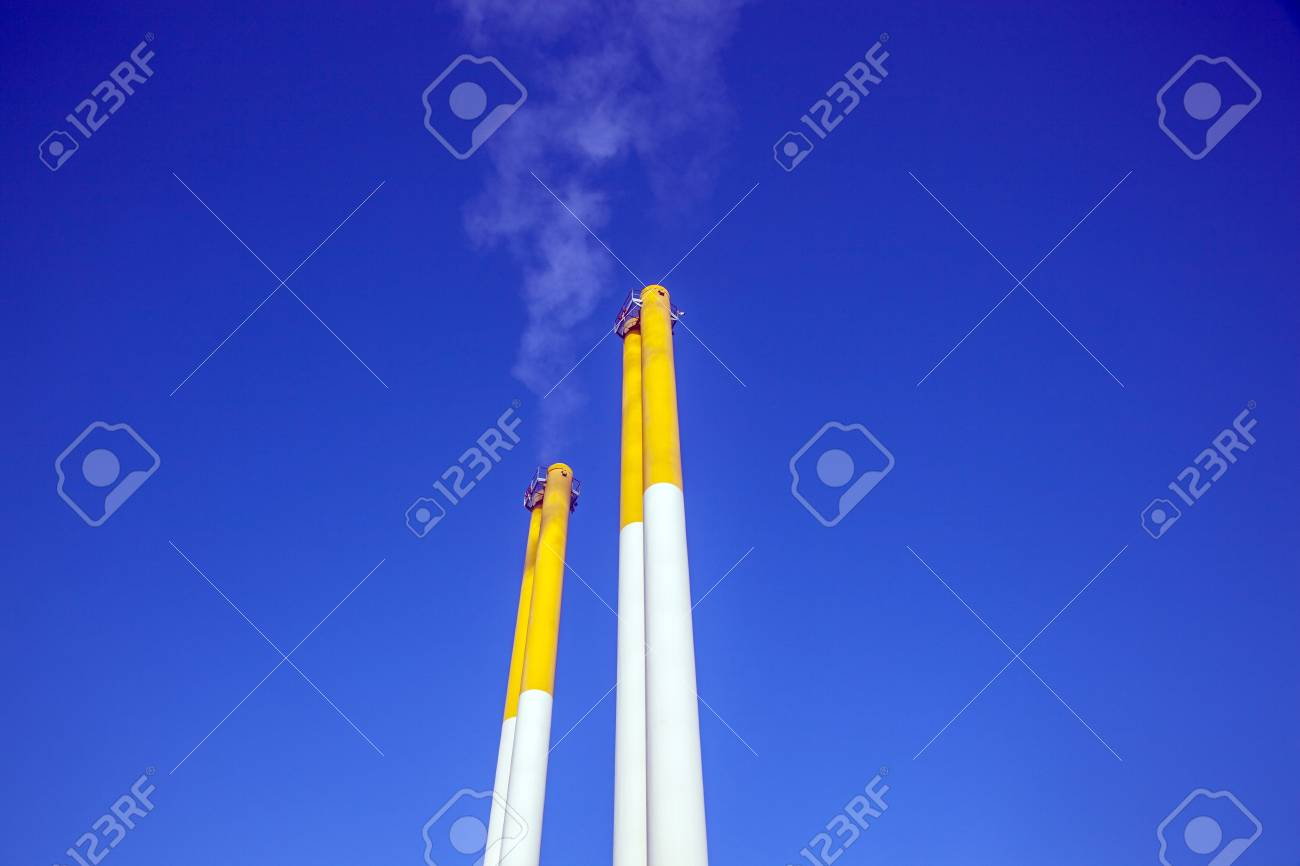 chimney with smoke and blue sky Stock Photo - 12983838