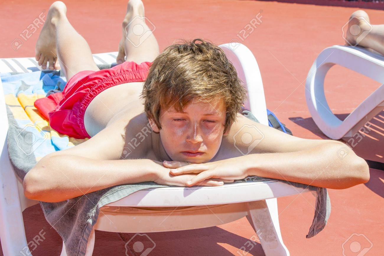 cute young boy sleeping at the pool Stock Photo - 13369635