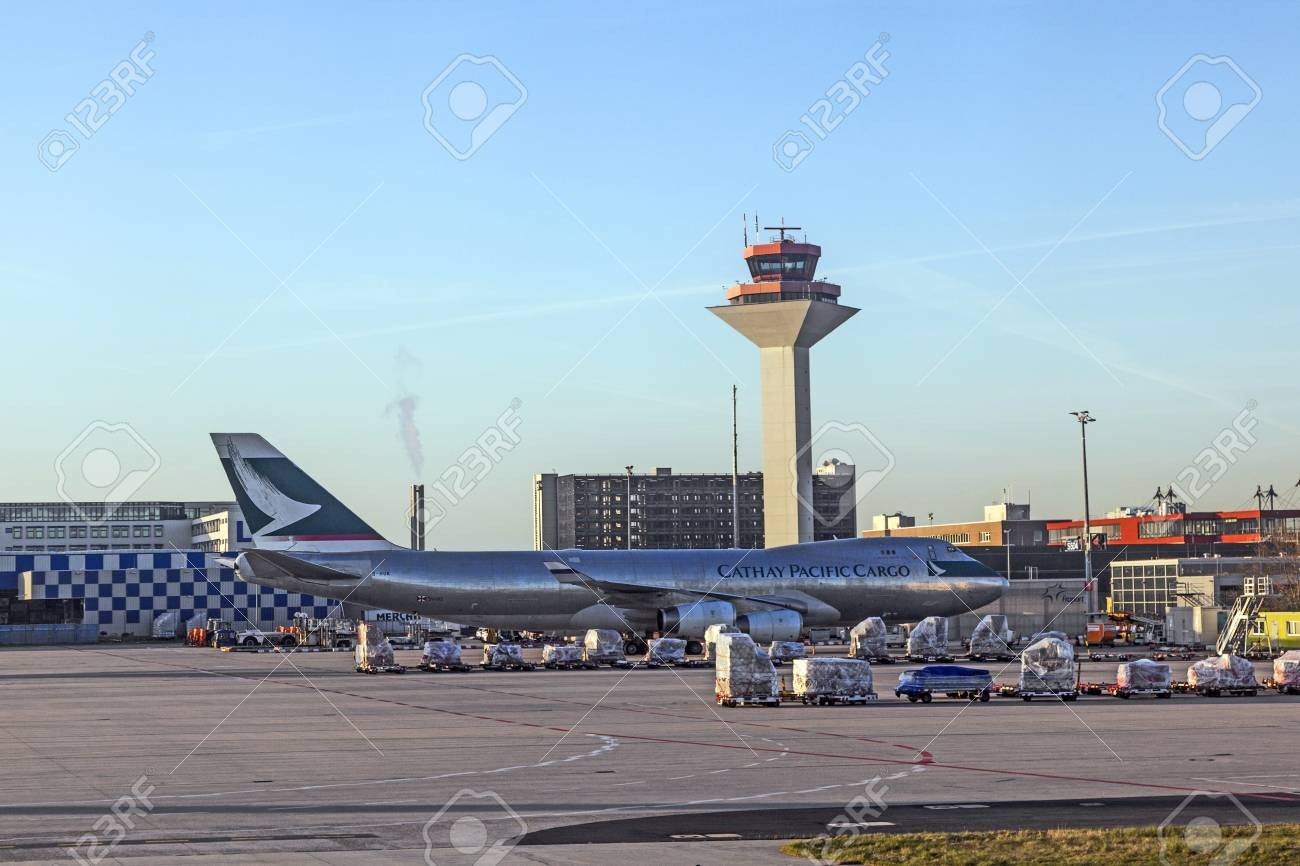 FRANKFURT, GERMANY - APRIL 1: Cathay cargo Jumbo with freight at Rhein Main airport early morning on APRIL 1, 2012. It is one of the busiest airports in Europe with 59 million passengers in 2011. Stock Photo - 13512018