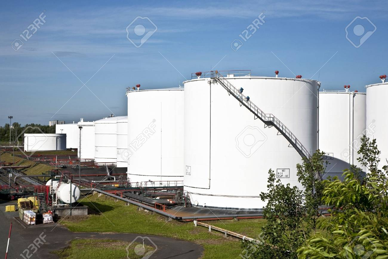 white tanks in tank farm with blue clear sky Stock Photo - 13567104