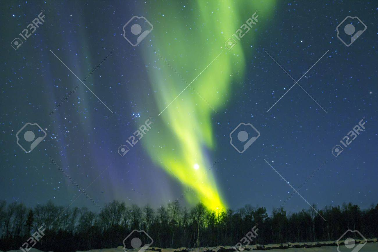 Northern Lights (Aurora borealis) over snowscape. Stock Photo - 14759366