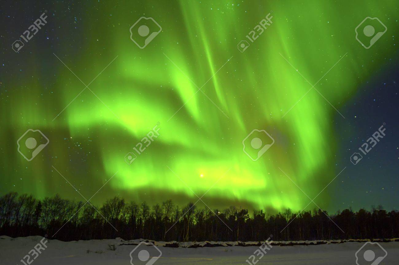 Northern Lights (Aurora borealis) over snowscape. Stock Photo - 14759338