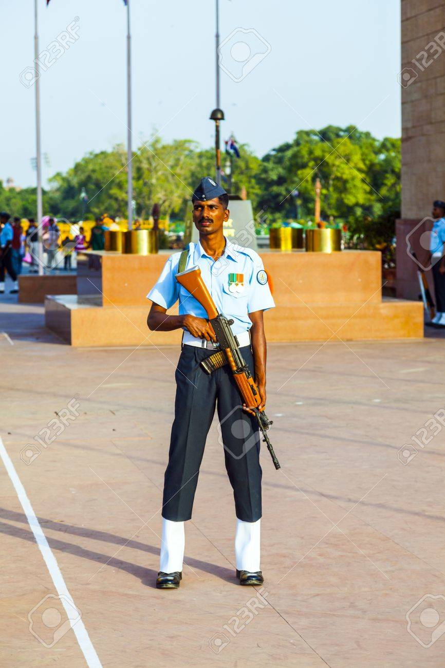NEW DELHI - INDIA, OCT 16: soldier in parade uniform guards the indian gate with a gun in his hand on October 16,2012 in Delhi, India. India Gate was erected 1921 by Edwin Lutyens. Stock Photo - 16377515