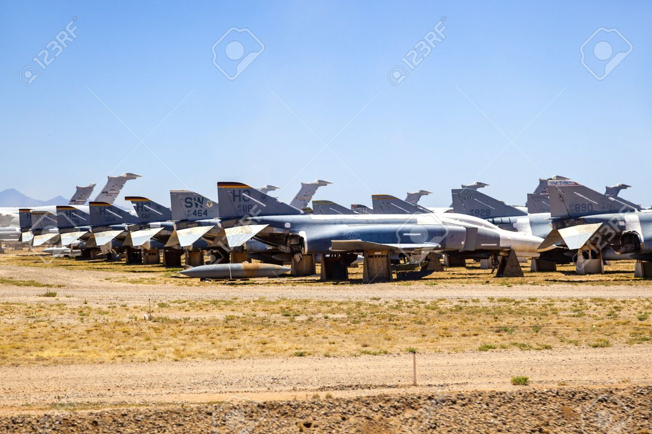 TUCSON, USA - JULY 14: view of bone yard, F4 fighter aircraft at Montham AFB at July 14, 2012 in Tuscon, USA. The aircrafts don't rust in that dry area. It is a big  aircraft parking garage for civil and military aircrafts. Stock Photo - 16979065