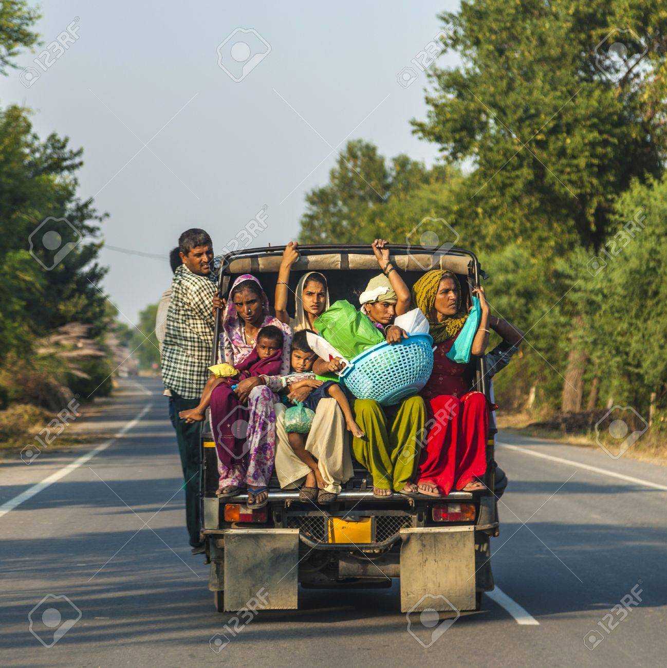DAOLA, INDIA - 25 OCT: people on highway 71 in overloaded truck on OCT 24, 2012 in Daoloa, India. Overload ist the most dangerous reason for car accidents. Stock Photo - 17393197