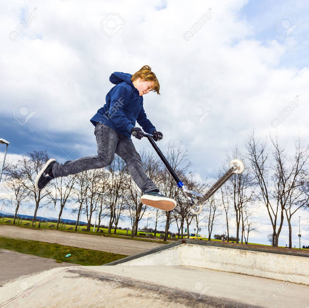 boy is going airborne witha scooter - 23698339