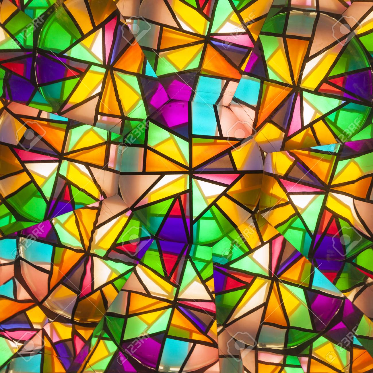 beautiful colored glass windows with asymetric pieces of different colors Stock Photo - 23882446