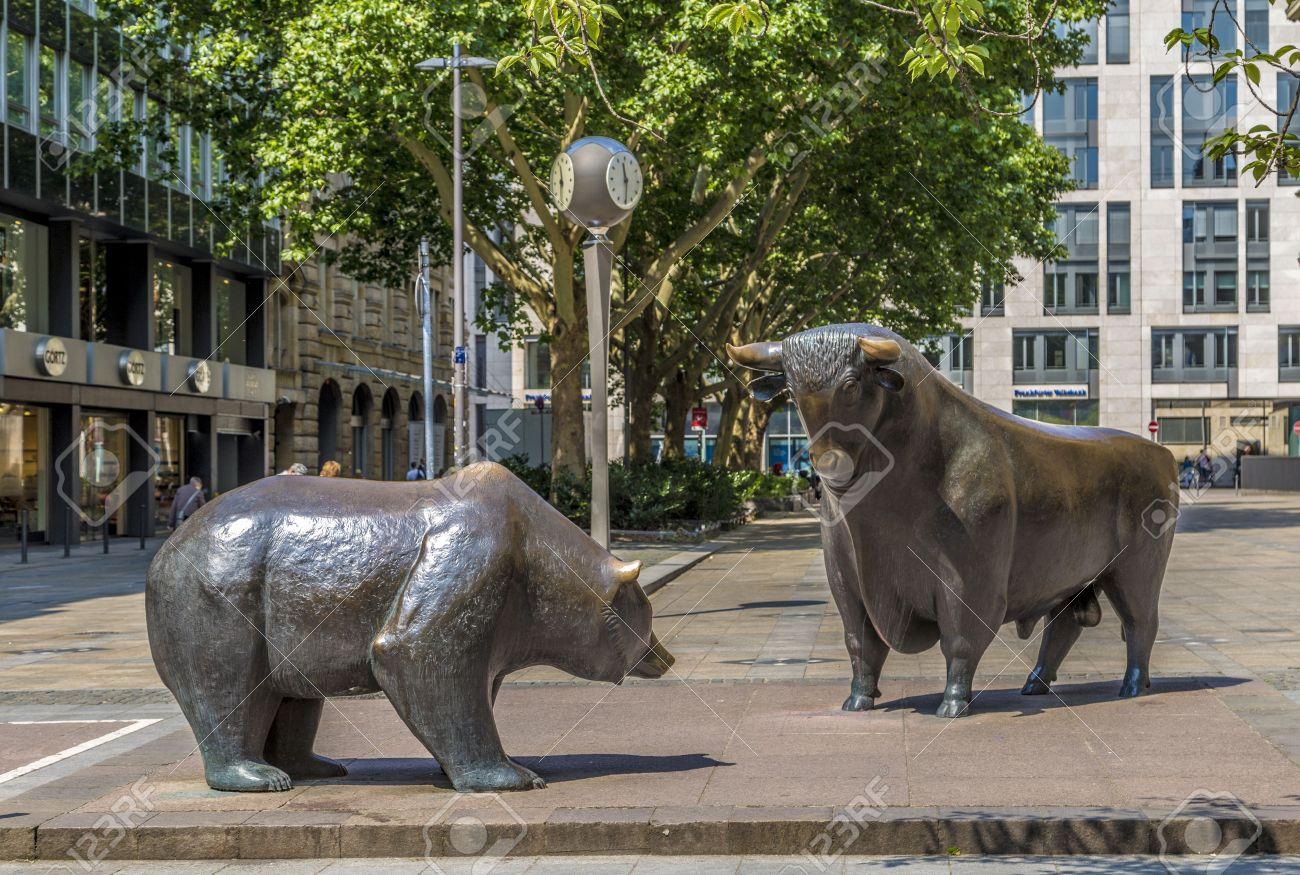 FRANKFURT, GERMANY - JUNE 3, 2014: The Bull and Bear Statues at the Frankfurt Stock Exchange in Frankfurt, Germany. Frankfurt Exchange is the 12th largest exchange by market capitalization. - 28812188