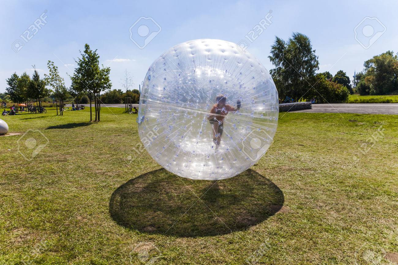 child has a lot of fun in the orbing Ball - 32052174