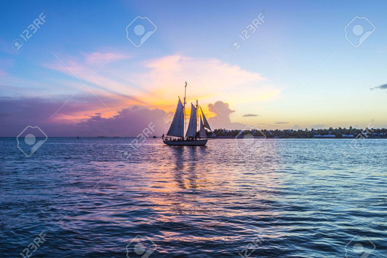 Sunset at Key West with sailing boat and bright sky - 36067239