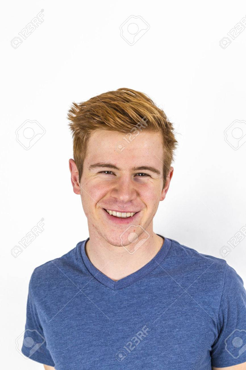 portrait of cool boy with red hair posing in studio - 44334090