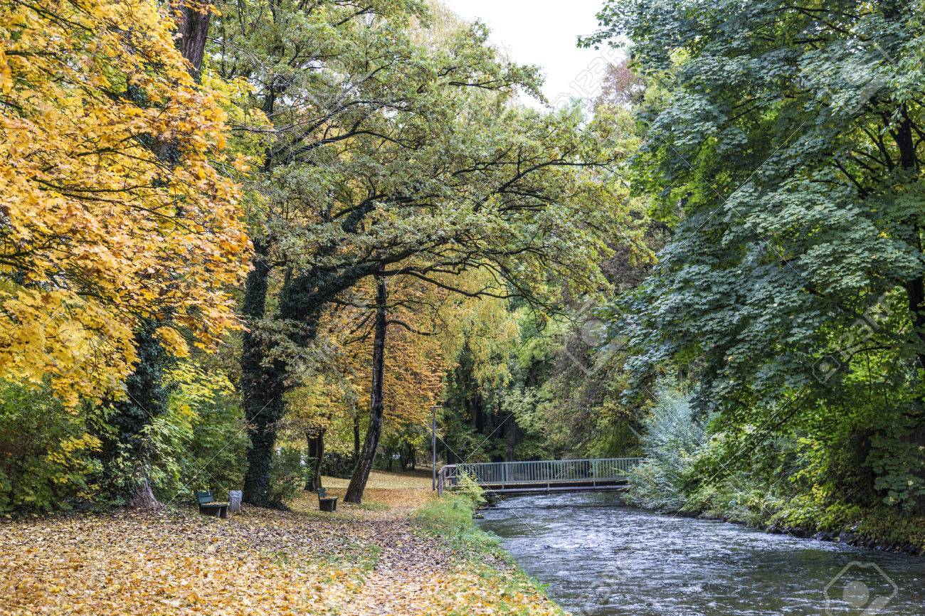 Beautiful River Wuerm With Green Trees In Munich In Autumn Color ...