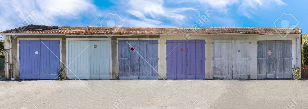 Pattern Of Garage Doors In A French Village Stock Photo Picture And