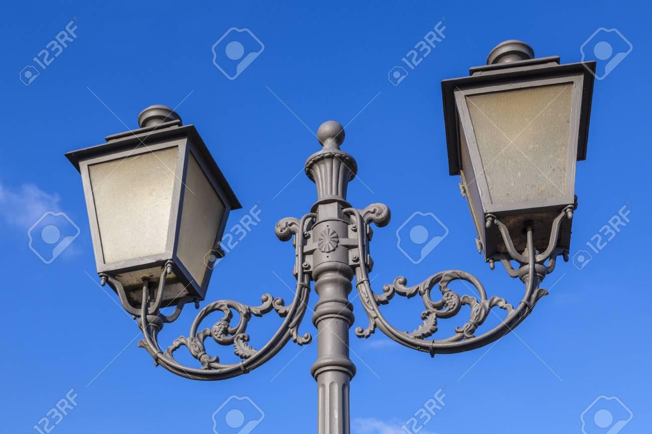 old vintage lantern under blue sky symbolize good former times - 97331706