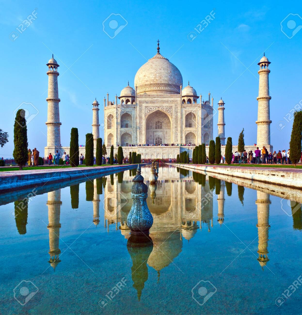 AGRA, INDIA - NOV 15, 2011: people visit beautiful Taj Mahal in India with blue sky - 140145422