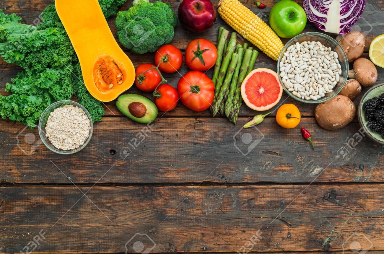 Fresh organic fruit and vegetables, white beans, oatmeal, and blackberries. - 134970969