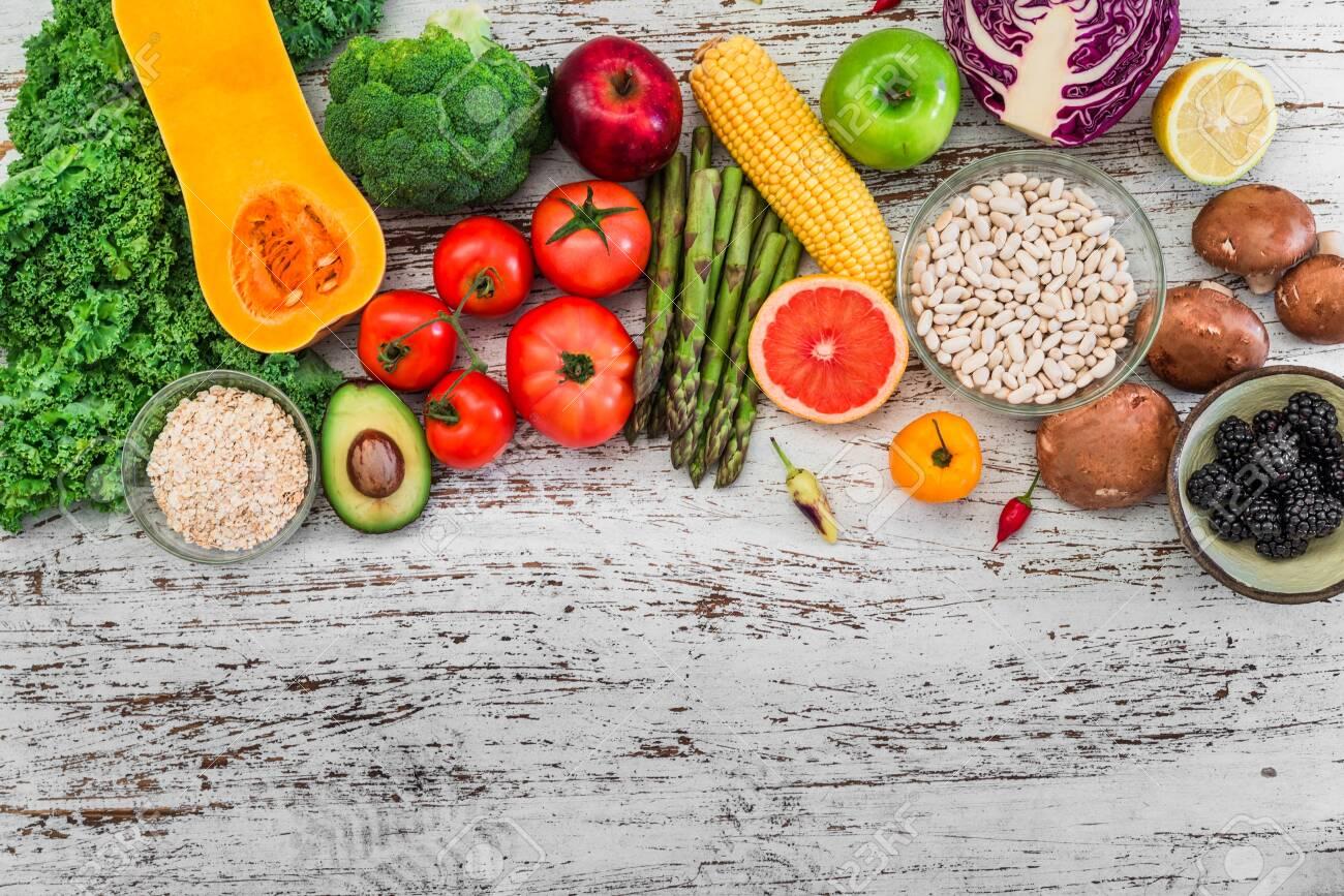 Fresh organic fruit and vegetables, white beans, oatmeal, and blackberries - 136017226