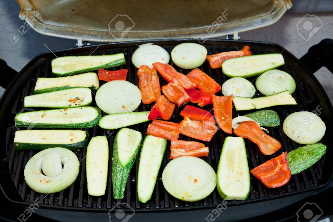 Grilling is a form of cooking that involves dry radiant heat from above or below, and takes place on a grill or griddle Stock Photo - 8031319
