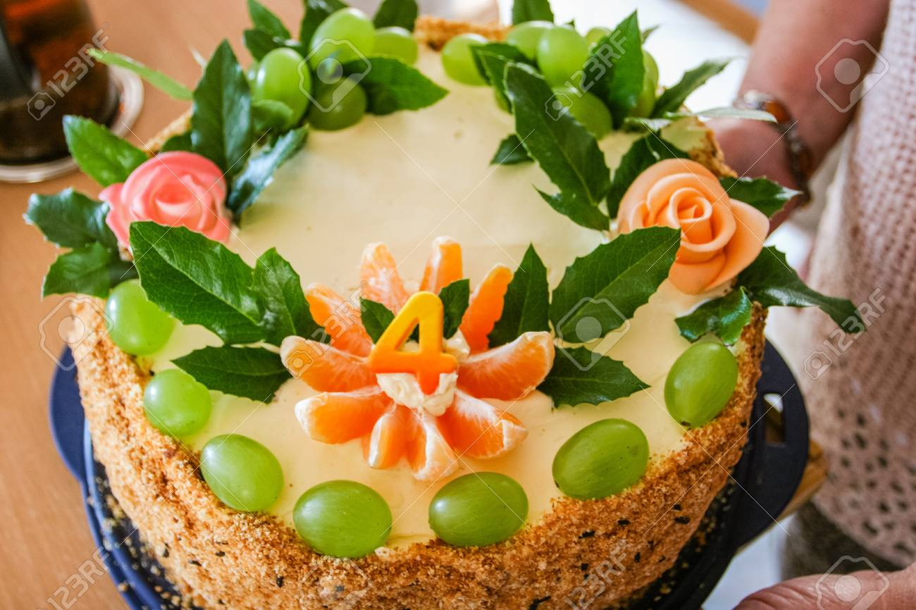 Home Made Round Walnut Birthday Cake With Fruits For Celebrating 4th Stock Photo
