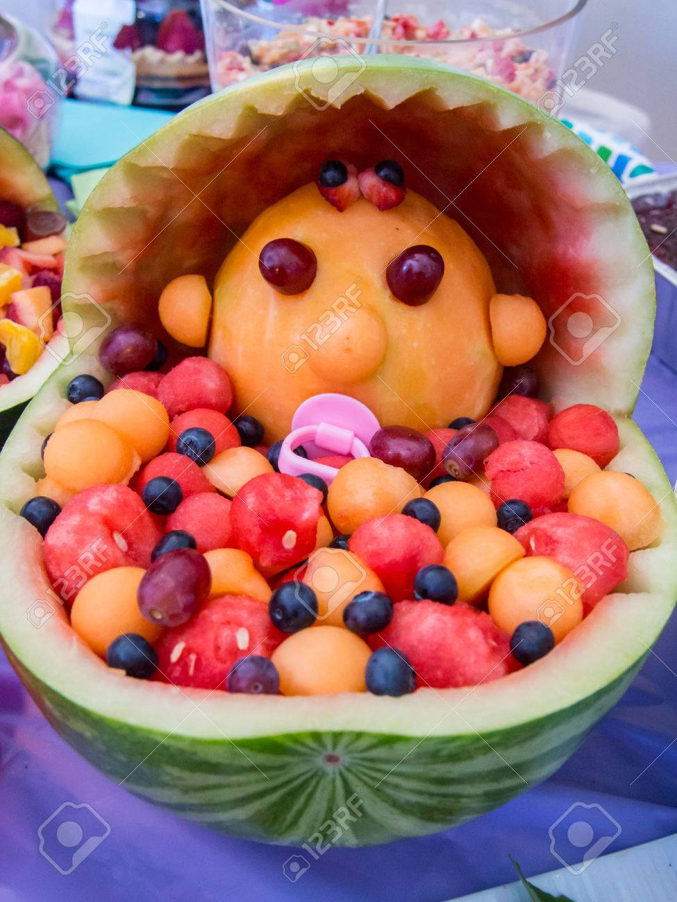 Colorful Baby Shower Fruit Sculpture Made Of Various Melons. Stock Photo    22407604
