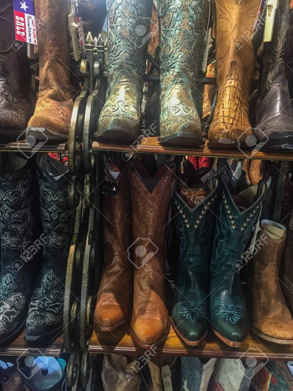 a30d16a27f0 Rows of cowboy boots on shelf in store in Dallas, Texas Stock Photo -  57890719