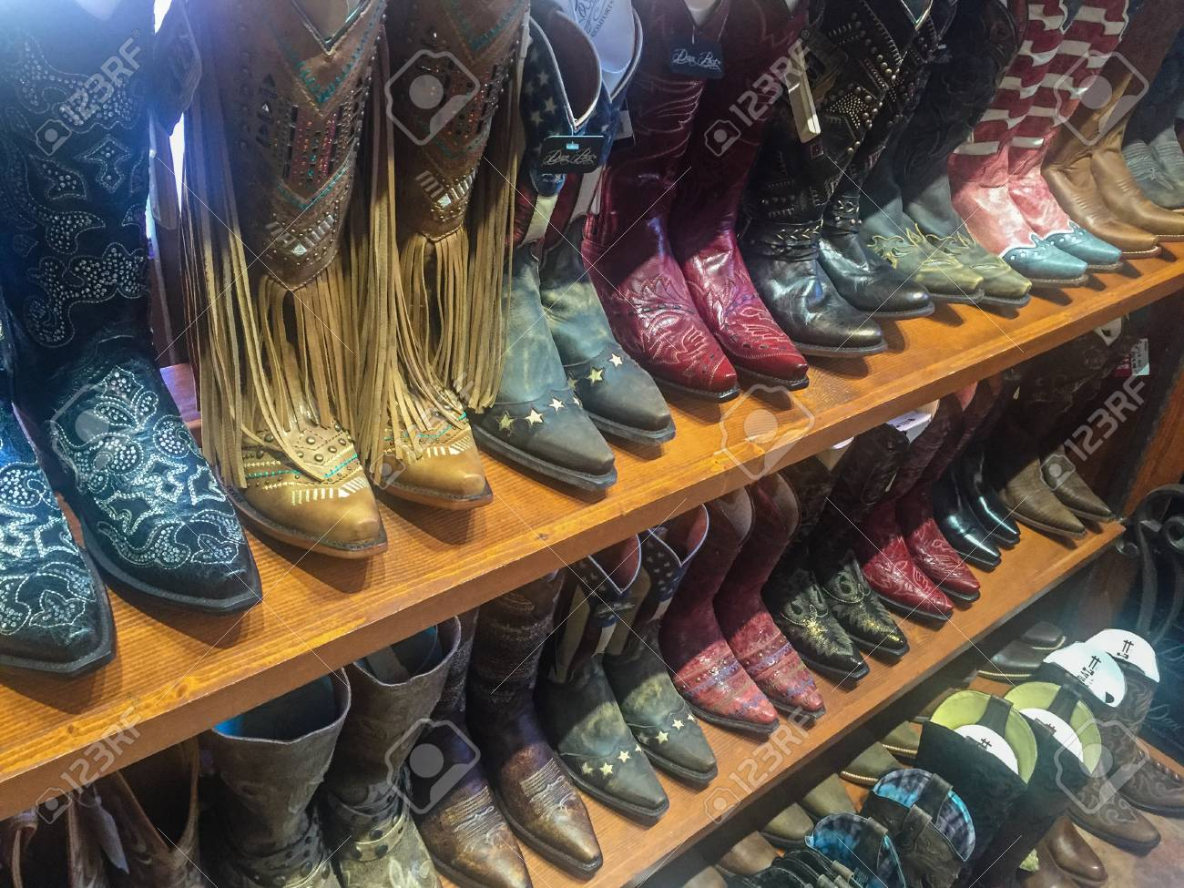 685ab60ff7c Rows of cowboy boots on shelf in store in Dallas, Texas Stock Photo -  60198802