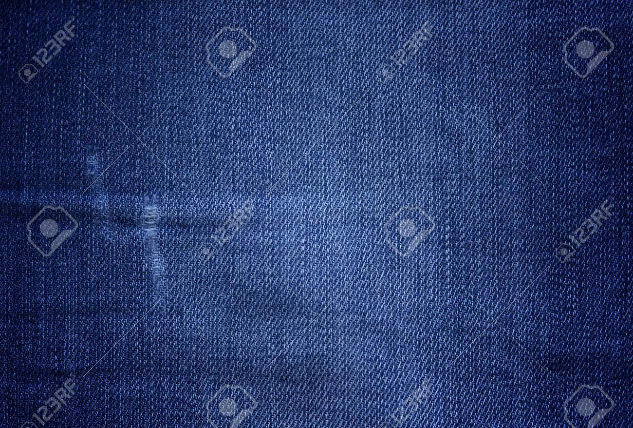 f6a3be88b Textura de mezclilla azul con pequeños roces y arañazos