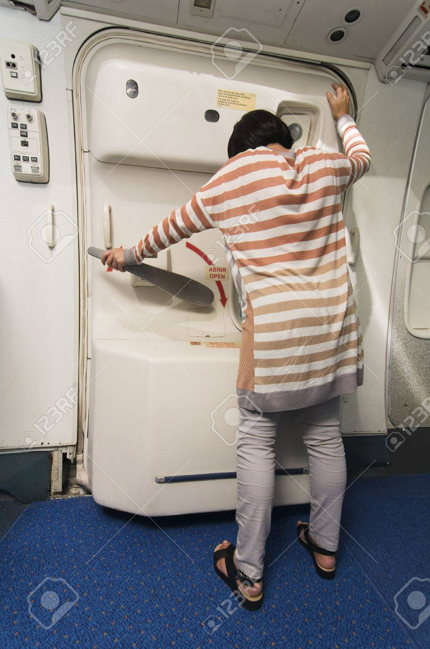 Stock Photo - caucasian woman passenger trying to open the emergency exit door in plane & Caucasian Woman Passenger Trying To Open The Emergency Exit ... Pezcame.Com