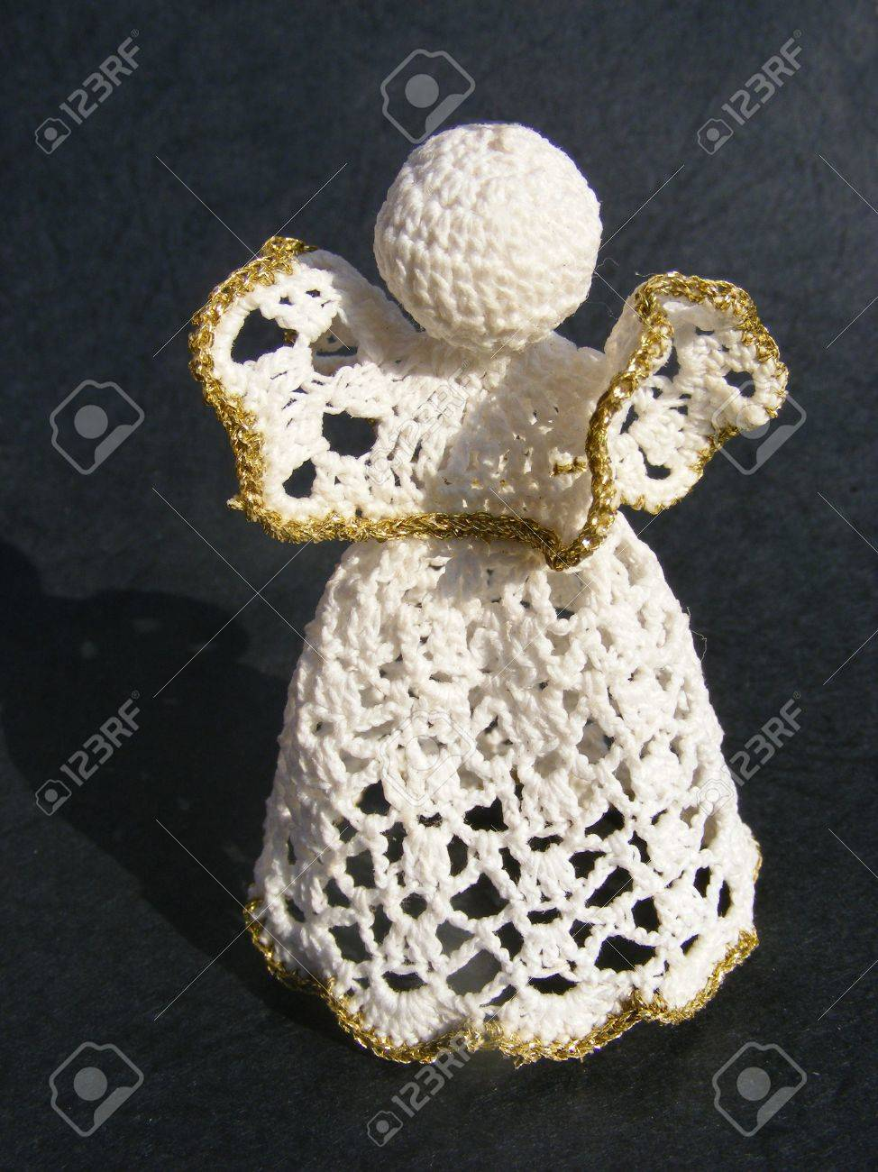 hand knitted angel on black background, christmas tree ornament Stock Photo - 6080243