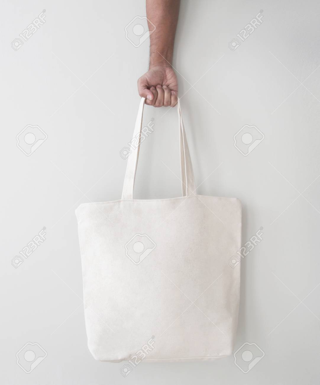 blank canvas tote bag design mockup with hand handmade shopping bags stock photo