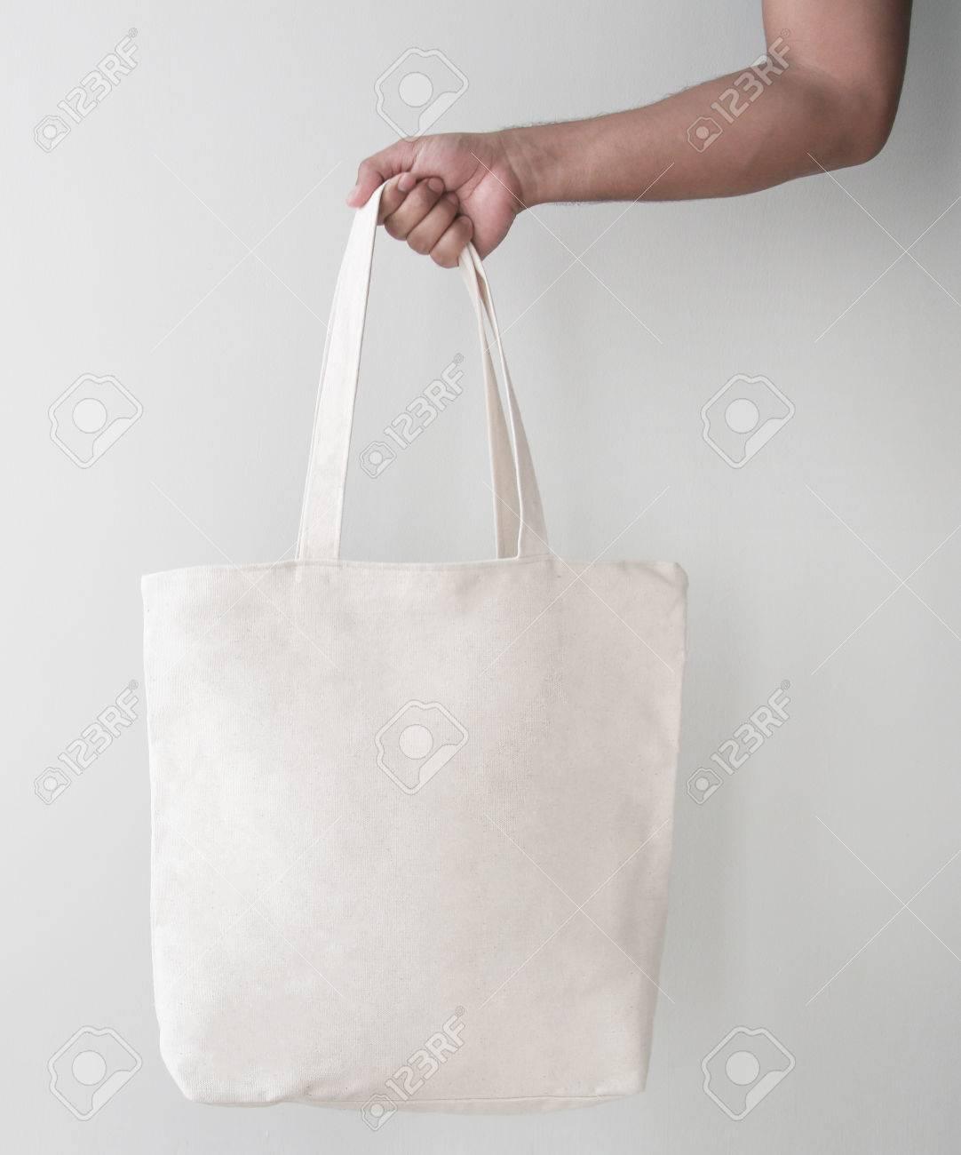 fa3b94f937c0 Blank canvas tote bag, design mockup with hand. Handmade shopping bags.  Stock Photo