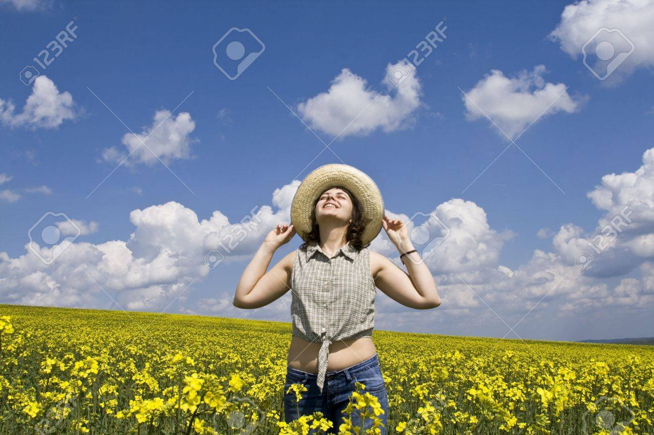 Young attractive girl enjoying summer rape field Stock Photo - 2955340