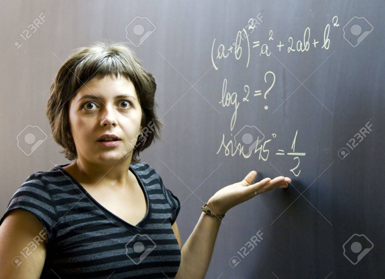 confused student in front of a math formula stock photo, picture and