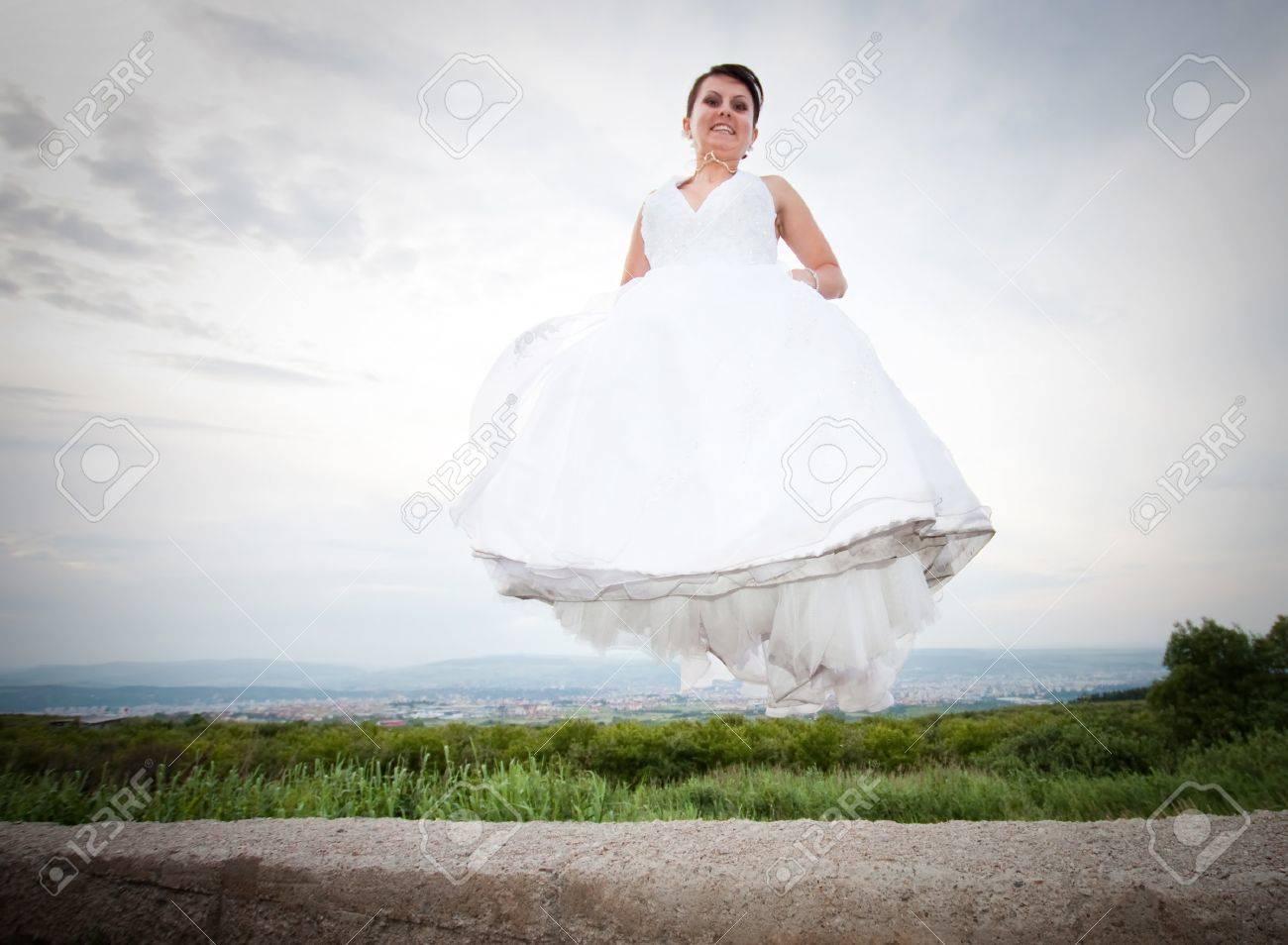 Happy bride jumping Stock Photo - 7347999