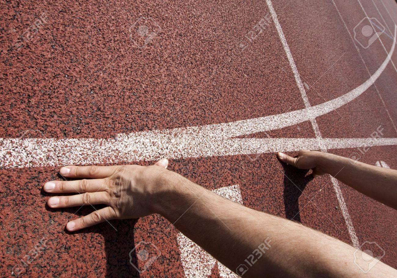 Runner at starting line - 9458214