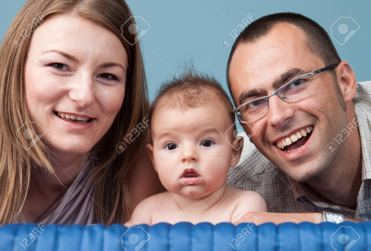 Beautiful young family with baby boy in bedroom Stock Photo - 9994862