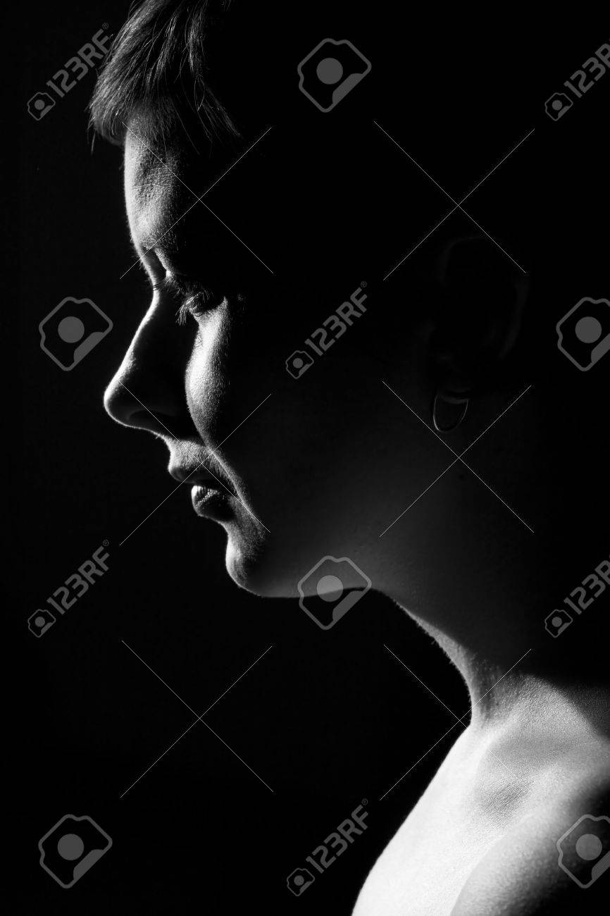 Low key portrait of a young woman stock photo 10669192